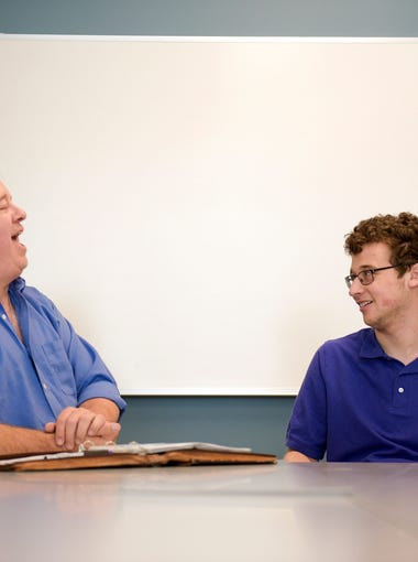 Comedians Harrison Brown, 19, right, and his father Peter Brown share a laugh while discussing their comedy Thursday, May 3, 2018 in Mount Laurel, N.J.
