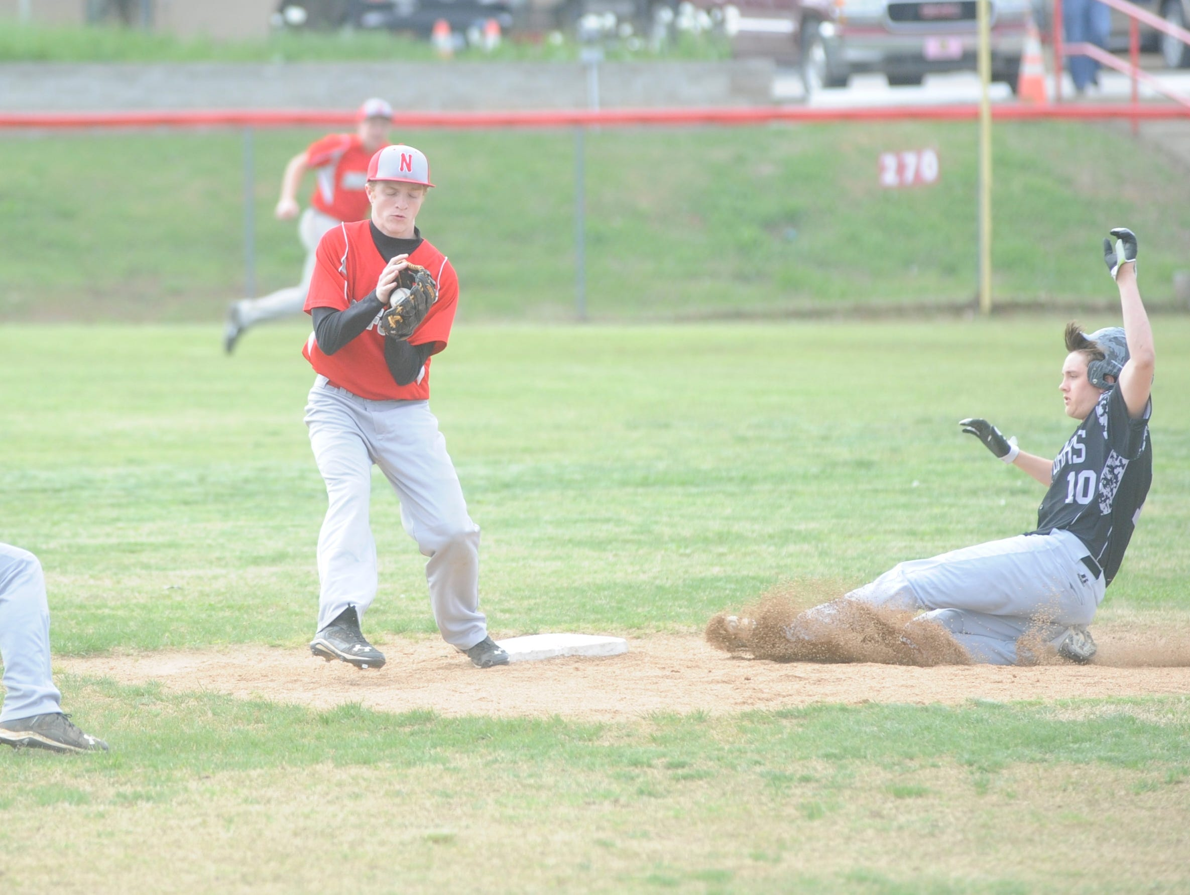 Norfork second baseman Grant Casey, middle, takes a throw from shortstop Quinn Ellison, left, for a force out as Izard County's Jake Everett slides into second base during the Panthers' 17-2 victory over the Cougars on Thursday at Fireball Reynolds Ballfield.