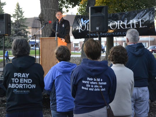 Shawn Carney, co-founder and president of the 40 Days for Life international organization, talks to a gathering of about 100 people at Baird Place Park in Green Bay for the kickoff of the local 40 Days for Life fall campaign to end abortion Wednesday night, Sept. 28.