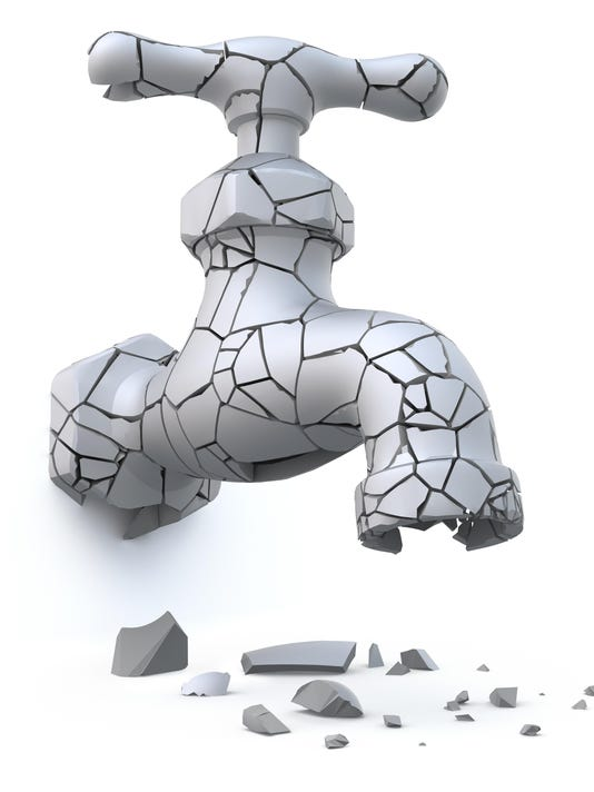 Broken cracked faucet (drought and global warming concept)