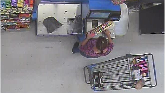 A surveillance photo of a woman suspected n the theft of an iPhone.