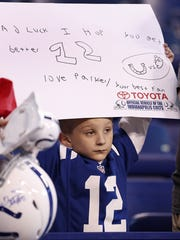 Parker Sharp,7, from Indianapolis holds up a sign for