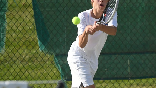 Drew Swisher of Findlay hits a running backhand return en route to claiming the boys 16 title in the 84th News Journal/Richland Bank/matchmatetennis.com Tennis Tournament at Lakewood Racquet Club.