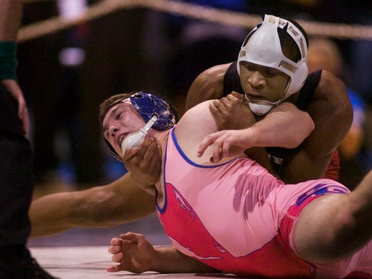 Dover's Shaheed Mitchell, right, tries to turn Spring Grove's Andy Melhorn during their 182-pound semifinal Saturday. Mitchell notched a 5-1 win. (The Evening Sun -- Shane Dunlap.)