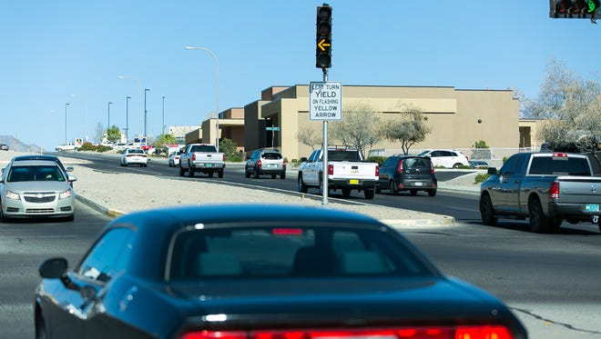 Yellow flashing traffic lights are recently installed at the intersection of East Lohman Avenue and Foothills Road on Tuesday, March 15, 2016.