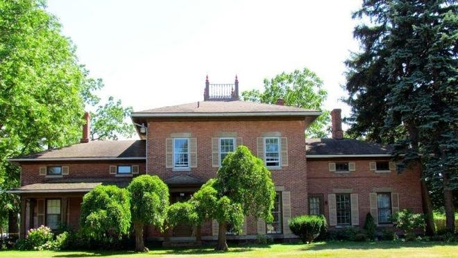 "The Fleming House in 2011. The Landmark Society of Western New York says it's an ""intact vernacular interpretation of Italianate style domestic architecture."""
