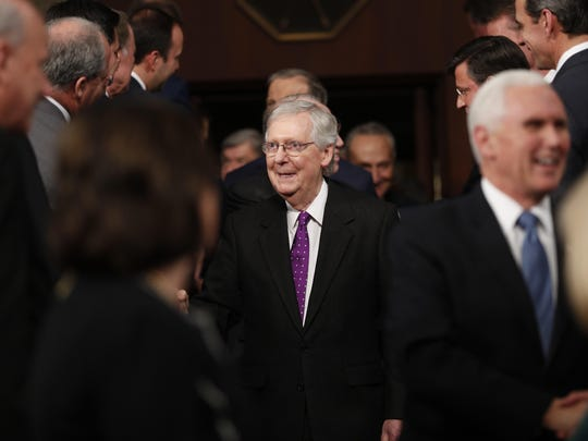 Senate Majority Leader Mitch McConnell of Ky., center, arrives with Vice President Mike Pence, right, before President Donald Trump arrives to delivers his State of the Union address to a joint session of Congress on Capitol Hill in Washington, Tuesday, Feb. 4, 2020. (Leah Millis/Pool via AP)