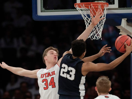 Penn State guard Josh Reaves (23) shoots next to Utah