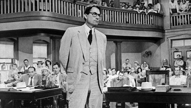 "In this file photo, Gregory Peck is shown as attorney Atticus Finch, a small-town Southern lawyer who defends a black man accused of rape, in a scene from the 1962 movie ""To Kill a Mockingbird."""