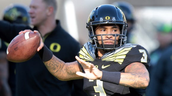 Nov 21, 2015; Eugene, OR, USA; Oregon Ducks quarterback Vernon Adams Jr. (3) throws the ball before the game against the USC Trojans at Autzen Stadium. Mandatory Credit: Scott Olmos-USA TODAY Sports
