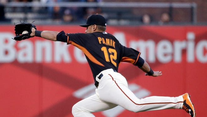 San Francisco Giants second baseman and Yonkers native Joe Panik makes a diving attempt at a ground ball