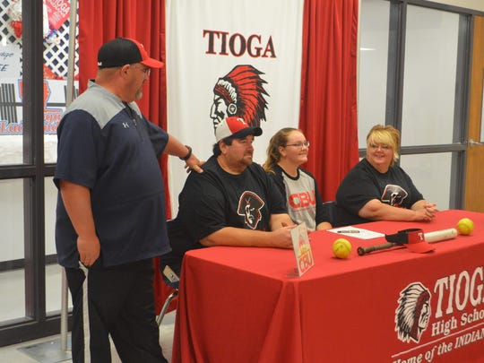 Tioga pitcher Macy Cumming (second from right) signed with Christian Brothers University Thursday.