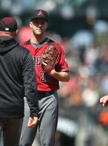 Arizona Diamondbacks' Brad Boxberger, center, is visited on the mound in the ninth inning of a baseball game against the San Francisco Giants Wednesday, June 6, 2018, in San Francisco. (AP Photo/Ben Margot)