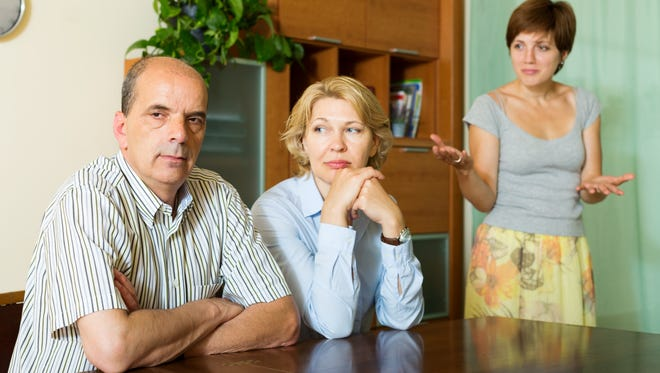 Mature parents with   daughter having a conflict  in home.