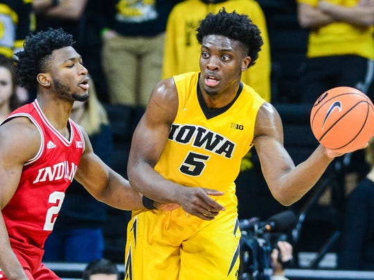 Iowa Hawkeyes forward Tyler Cook (5) is defended by Indiana Hoosiers guard Josh Newkirk (2) during the first half at Carver-Hawkeye Arena.