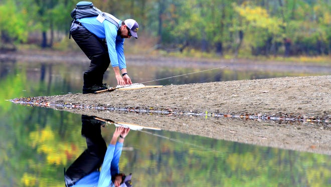 Chris Tahmoosh, of Waldwick, picks up his fishing gear at Scarlet Oak Pond at Ramapo Valley County Reservation.