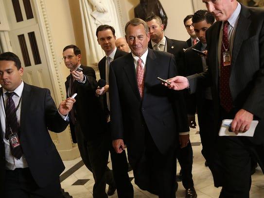 House Speaker John Boehner walks to the House chamber