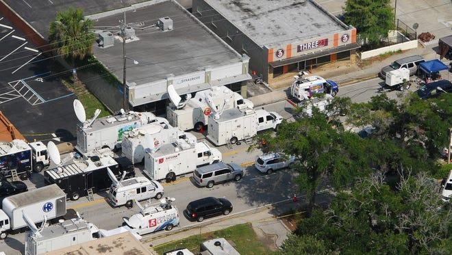 News media vans outside the Orlando nightclub after terrorist attack in 2016.