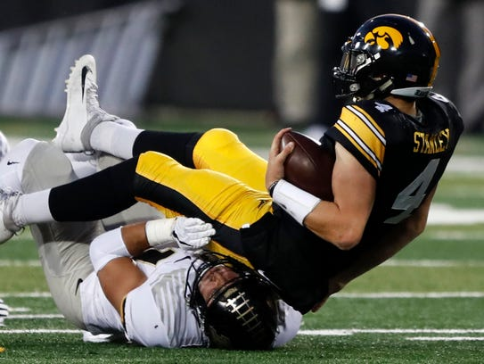 Iowa quarterback Nate Stanley (4) is sacked by Purdue