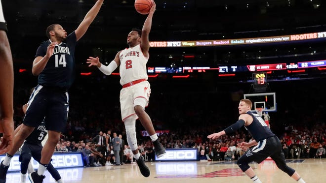 St. John's Shamorie Ponds (2) shoots over Villanova's Omari Spellman (14) during the second half of an NCAA college basketball game Saturday, Jan. 13, 2018, in New York. Villanova won 78-71. (AP Photo/Frank Franklin II)