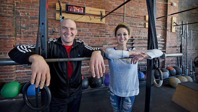 J. P. Pocock and Jenna Hendershott are joining forces at the new Downtown Fitness. The facility is upgrading with new fitness equipment and will have a grand opening on March 2.