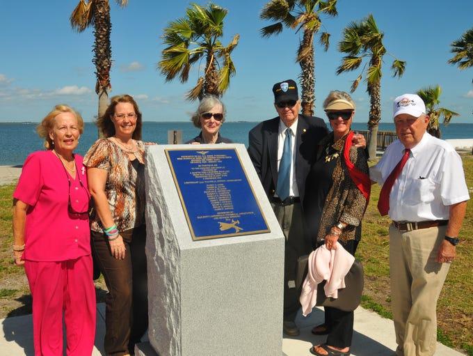 Family members of  retired Army Captain Jon Myhre (third