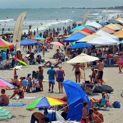 Crowds pack the area around the Cocoa Beach Pier on Labor Day weekend during the 29th annual NKF Rich Salick Pro/Am Surf Festival in Cocoa Beach.