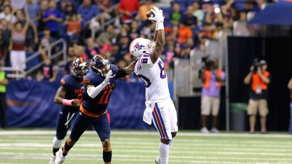 Louisiana Tech wide receiver Kam McKnight catches a pass in a win earlier this season over UTSA.