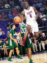 Alex Lomax of Memphis East goes to the basket against