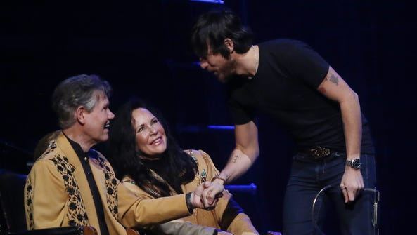 Chris Janson greets Randy and Mary Travis during the