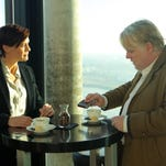 "Philip Seymour Hoffman and Robin Wright appear in a scene from ""A Most Wanted Man."""