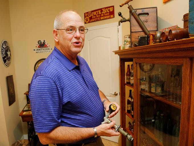 Walt Griffin shows a Thieme & Wagner beer tap Thursday,