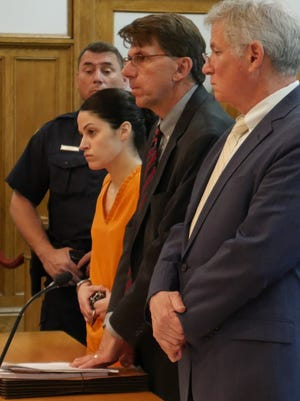 Nicole Addimando stands with her two defense attorneys, Benjamin Ostrer, of Ostrer & Associates (right) and John Ingrassia of Larkin, Ingrassia & Tepermayster, in Dutchess County Court during her arraignment on July 2, 2018.