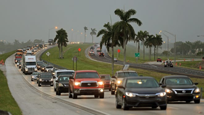 Traffic is seen heading North along the Florida Turnpike near Homestead, Fla.,  as tourists in the Florida Keys leave town on Wednesday, Sept. 6, 2017. Heavy rain and 185-mph winds lashed the Virgin Islands and Puerto Rico's northeast coast Wednesday as Hurricane Irma roared through Caribbean islands on its way to a possible hit on South Florida.