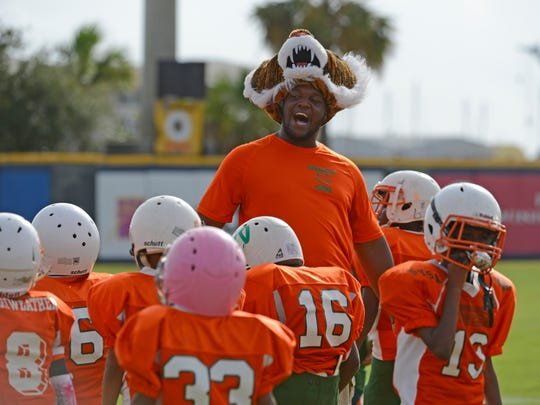 Pensacola Tigers coach Tim Henderson cheers on his team Saturday, October 21, 2017 during the 2017 Soul Bowl at Blue Wahoos Stadium.
