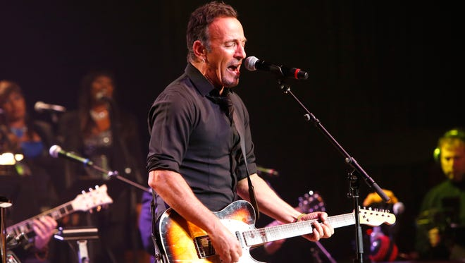 Bruce Springsteen performs during 'The Musical Mojo of Dr. John: A Celebration of Mac & His Music' at the Saenger Theatre on May 3, 2014, in New Orleans, Louisiana.