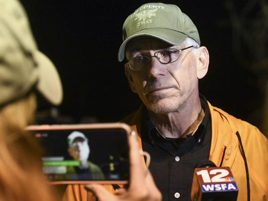 Lee County Sheriff Jay Jones speaks to reporters at the staging area at Sanford Middle School in Beauregard, Ala., Sunday, March 3, 2019, after tornados ravaged the area, causing multiple deaths. (AP Photo/Julie Bennett)