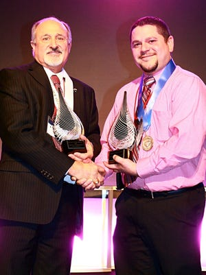 Rod Drendel, left, broker/owner of RE/MAX Heritage, Fond du Lac, and Gus Garcia, right, sales associate, both receive awards for their sales achievements in 2014, at the RE/MAX Integra Midwest regional awards celebration Feb. 20. Not present: Elizabeth Thome, also received a sales award. See article below for award details.