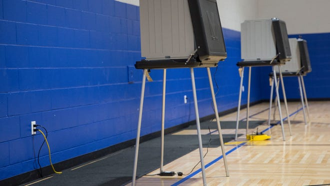 Empty polling booths were a common site across the area including the polling center at the Ross Center. According to poll workers, turnout was relatively low.