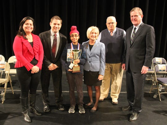 On March 11, Somerset County Library System of New Jersey (SCLSNJ) hosted the 2017 Bee Spectacular, a countywide spelling bee. Nearly 50 local children grades 3-8 participated. The winner was Anmol Bhatia of Green Brook, who attends Green Brook Middle School. Bhatia will go on to represent Somerset County at the Scripps National Spelling Bee this spring. From left: Corrine Fender, SCLSNJ Library Commission member; Chris Corsini, SCLSNJ Library Commission chairman; SCLSNJ's 2017 Bee Spectacular winner Anmol Bhatia; Pat Walsh, Somerset County freeholder; Elias Ezra, Bridgewater-Bound Brook Rotary president; and Michael Kerwin, president of Somerset County Business Partnership.
