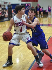 Reno's Kyle Rose looks to pass the ball with Carson's Geraet Rauh covering him Tuesday at Reno.