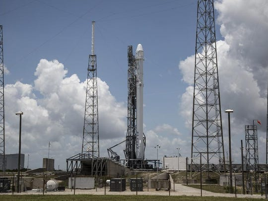 A SpaceX Falcon 9 rocket and Dragon capsule on the pad at Cape Canaveral Air Force Station's Launch Complex 40. The rocket on Friday completed a successful test-firing of its nine main engines.