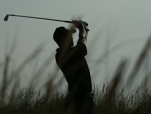 Tiger Woods watches his shot from the 13th tee during his second round, on day two of the 2014 British Open Golf Championship at Royal Liverpool Golf Course.