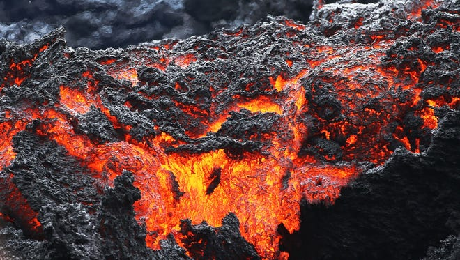 Lava flows at a lava fissure in the aftermath of eruptions from the Kilauea volcano on Hawaii's Big Island on May 12, 2018 in Pahoa, Hawaii.