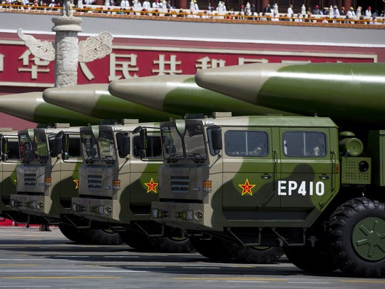 Military vehicles carrying DF-26 ballistic missiles, drive past the Tiananmen Gate during a military parade to mark the 70th anniversary of the end of World War II on Sept. 3, 2015 in Beijing.
