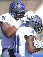 Joey D. Richards/Reporter-News Central Arkansas' Cardell Best (91) celebrates with George Odum (31) after Odum returned an interception 18 yards for a touchdown to give the Bears a 37-13 lead with 57 seconds left in the first half. UCA won the game 58-27 on Saturday, Oct. 1, 2016 at Shotwell Stadium.