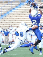 Arthur Spragg/Special to the Standard-Times Lake View Chiefs receiver Jesse Scott out leaps Fort Stockton Panther defender Johnny Ybarra for Scott's first touchdown catch Friday against the Fort Stockton Panthers in a non-district game at San Angelo Stadium.