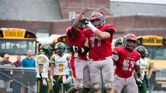 Vineland's Alaattin Ardahan (77) and Isaih Pacheco (1) celebrate a touchdown during a homecoming game against Clearview Saturday, Oct. 14, 2017 in Vineland. Vineland won 55-21.