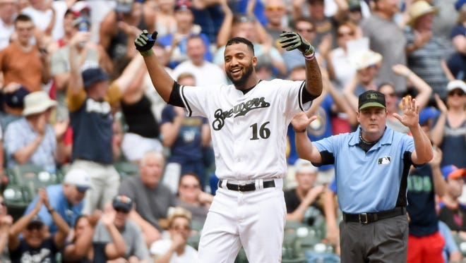 Milwaukee Brewers right fielder Domingo Santana (16) reacts after hitting a double to drive in 2 runs in the seventh inning against the New York Mets at Miller Park.