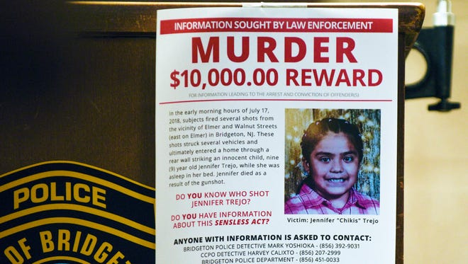 A flyer offering a reward for information on the death of 9-year-old Jennifer Trejo hangs from a podium during a press conference Tuesday, July 17, 2018 in Bridgeton, N.J. Trejo was  killed by a stray bullet that went through a wall of her home at approximately 12:30 a.m. Tuesday.